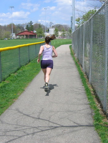 running by fence